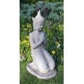 Kneeling Buddha sculpture